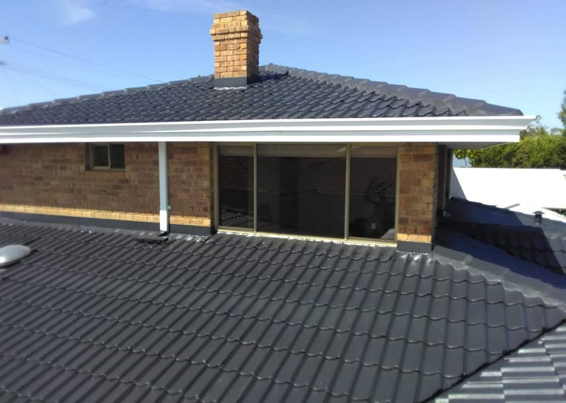 roof restoration in Rockingham, WA showing repaired and coated tiles on 2 levels of the roof.